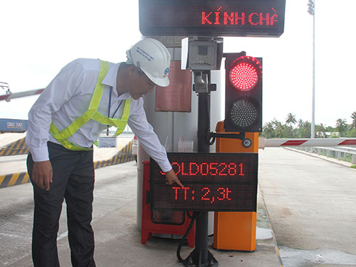 Place the weighing stations at toll booths to strangle overloaded vehicles